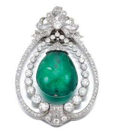 EMERALD AND DIAMOND PENDANT, CIRCA 1905 Designed as a bow suspending a polished emerald drop, embellished with millegrain set single- and circular-cut diamonds.