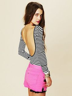 FASHION KNIT FIT: Striped low top - either you need to be comfortable with your ta-tas flopping around, have small ta-tas (lucky putas), or a corset that is low enough in the back but has enough structure in the front to hold the girls up. Sexy look though...