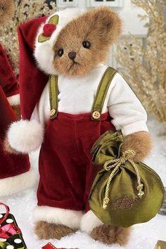 teddy bear dressed as santa claus with red velvet pants held on by suspenders.