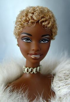 Medium-dark brown black doll with short blonde curls.