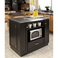 @Overstock - Transform the look of your kitchen in seconds, and add more storage and organization with this stainless-steel-top island. The black finish and steel top has a contemporary feel, and the multiple shelves and drawers will house all of your essentials.http://www.overstock.com/Home-Garden/Versatile-Stainless-Steel-Top-Island/6626613/product.html?CID=214117 $561.72