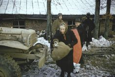 Belgian civilians are evacuated by American troops, 1944.