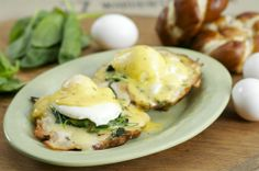 Greenleaf's Eggs Benedict. Pretzel Bread, Truffled Spinach, Caramelized Onions, Aged Cheddar Cheese, Hollandaise Sauce and Poached Eggs.
