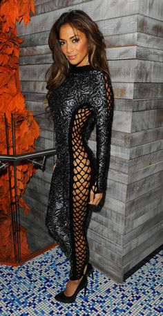 NicoleScherzinger1.jpg -- As the former lead singer of the Pussycat Dolls, Nicole Scherzinger knows a thing or two about feline-inspired fashion. That said, we never expected the sexy songstress to actually channel her inner Catwoman by sporting a fishnet catsuit … in public. On Tuesday night, Nicole attended the one-year anniversary party for Sushi Samba in London and left little to the imagination in the body-con getup, which could only be worn sans undergarments. Is her da