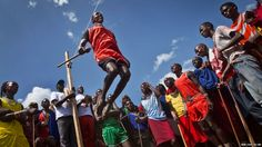 A Maasai warrior does the high jump, in which athletes must touch a high line with the top of their heads, at the annual Maasai Olympics in the Sidai Oleng Wildlife Sanctuary near Kilimanjaro, in southern Kenya.