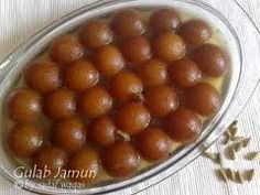 Called as Gulab Jamun. Made with all purpose flour and sugar syrup..    Yummyy Dessert !!