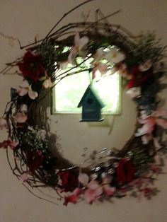 Made a new wreath from my yard vines and my brothers weddind flowers. Hanging on back door. So much fun ;)