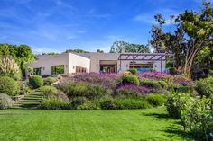 Purchased for $3.45 million, the home is perched atop a flower-soaked, beautifully-manicured mountain. Though the actor will never bid adieu to his home country of Australia, this real estate beauty gives the Land Down Under a run for its money.