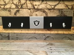 A personal favorite from my Etsy shop https://www.etsy.com/listing/459654528/oakland-raiders-4-hook-hat-coat-rack