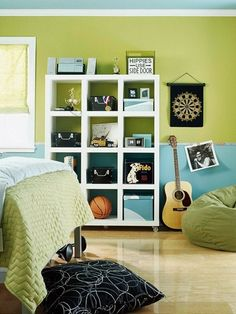 The cooler tones of green and blue are a no fail combination when decorating a boy's space.  Pull in masculine accents in shades of black or gray for contrast.