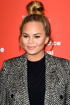 Bazaar beauty experts share how to achieve chic top knot buns, sleek ponytails, sultry curls, and more here: Chrissy Teigen