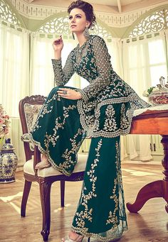 Dark Green Embellished Indian Gharara Palazzo Suit features very intrinsic designer embroidery with zari stone and pearl detail over its net top paired with matching ghera embroidered net palazzo b. New Pakistani Dresses, Walima Dress, Indian Gowns, Pakistani Dress Design, Indian Outfits, Stylish Dress Designs, Stylish Dresses, Fashion Dresses, Party Wear Dresses