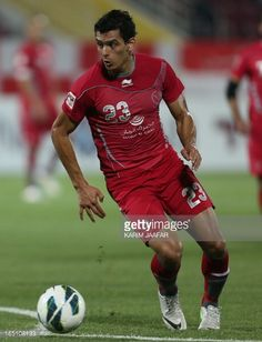 Qatar's Lekhwiya player Sebastian Soria runs with the ball during their Qatar Stars League football match on March 30 2013 in the Qatari capital Doha...