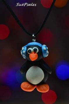 Penguin Necklace, Christmas Necklace, Winter Necklace, Polymer Clay Penguin, Penguin Pendant, Penguin blue earmuffs, Christmas Party Jewelry by SuePsales on Etsy #Penguin #PenguinNecklace #PolymerClayPenguin #ChristmasNecklace #ChristmasJewelry #ChristmasPartyJewelry #ChristmasPartyNecklace