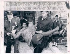 A woman civil-rights picket is hauled off bodily by police as they arrested more than 125 demonstrators at the all-negro Franklin school 11/14. The day before, 158 of the pickets wer arrested, and most of them were still in County jail when the new arrests took place. The demonstrators went to see the all-negro school closed, while Chester officials threaten to call in the State Police and National Guard if necessary to keep it open, November 14, 1963.  Photo credit: UPI telephoto