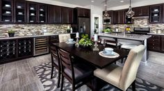 Transitional kitchen with dark cabinets dining island and l shape design