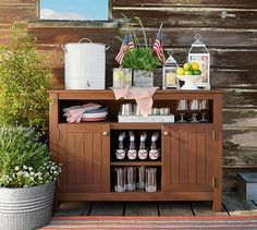 Simplify outdoor entertaining with our Chatham Buffet. Crafted with care from FSC® mahogany, it features a wide overhanging top that's perfect for buffet-style dining. The slatted cabinets and adjustable shelves below provide ple Outdoor Buffet Tables, Outdoor Dining, Outdoor Decor, Outdoor Bar Cart, Outdoor Patios, Outdoor Spaces, Weathered Furniture, Outdoor Furniture, Industrial Furniture