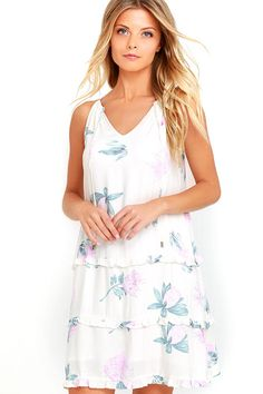 You'll always be ready to get some sun in the Mink Pink Woratah Cream Floral Print Shift Dress! A tying, drawstring neckline supports a sleeveless V-neck bodice. Lightweight woven fabric (with a teal blue and pink floral print) drops at the waist into a tiered skirt with ruffles.