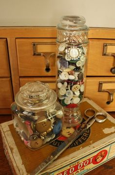 A collection of vintage buttons in apothecary jars, ready to be used to repair any buttonless emergency!