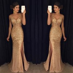 Gorgeous Sexy Gold Rhinestone Side Slit Long Prom Dresses   The dress is fully lined, 4 bones in the bodice, chest pad in the bust, lace up back or zipper back