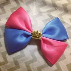 I love this and the way it has the pink/blue debate on the dress. :) Sleeping Beauty Inspired Bow by BeautyandtheBows13 on Etsy, $3.00
