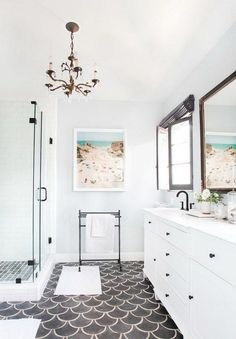 Love the fish scale tiles in this white bathroom.