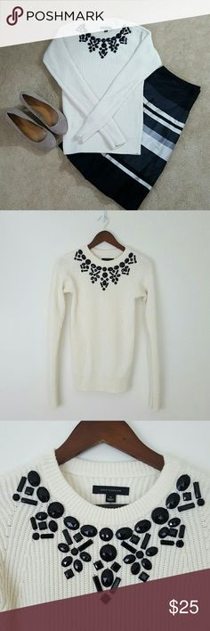 Ann Taylor Sweater Beautiful Off-white/cream colored crew neck sweater. Long sleeves Black plastic bead form a jeweled neckline.   40% viscose, 30% Nylon, 30% wool.  EUC, Hand washed.  Size small Ann Taylor Sweaters Crew & Scoop Necks