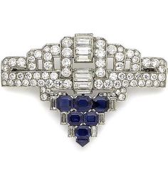 An art deco sapphire and diamond brooch, circa 1935 The openwork plaque of geometric design, set with a central row of baguette-cut diamonds, within a brilliant-cut diamond surround, and terminating in a cluster of step-cut sapphires accented by baguette-cut diamonds with a shield-shaped sapphire finial, diamonds approx. 5.00cts total, width 5.0cm