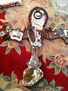 My vintage, rusty but much in love with, barn wood cross.....mixed in with a little handmade flowers~