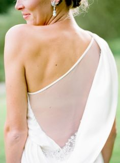 Modern one shoulder with a sheer back: http://www.stylemepretty.com/2014/07/22/wedding-dress-back-styles-we-love/