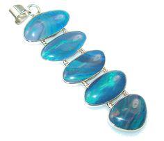 $63.25 Fantastic Blue Fire Opal Sterling Silver Pendant at www.SilverRushStyle.com #pendant #handmade #jewelry #silver #opal