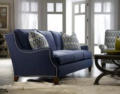 Energy meets style in the Tansy Sofa, with a jaunty silhouette and dapper denim-blue cover. Photo: Sam Moore Furniture.
