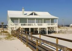 Gulf Shores, AL: This exquisite beachfront 5-bedroom, 3-bathroom, 1-level Gulf Shores beach home is nestled on the sugar white sands of the Alabama Gulf Coast. Rolling...