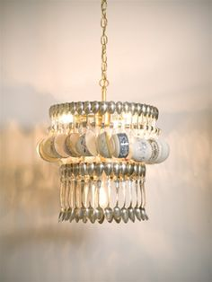 Vintage teacups + old teaspoons = adorable kitchen chandelier.