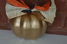 Paint a foam pumpkin with gold spray paint.  www.reservationsforfive.com