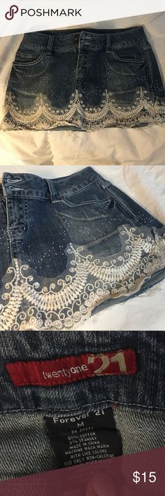 Denim Mini Skirt with Lace Detail Denim mini skirt with double button and zipper closure, Lace detail and silver embellishments. 4 pockets. Pretty good condition. I loved this skirt but have out grown it :( Size Medium. Forever 21 Skirts Mini