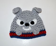 This crochet pattern comes with complete instructions for this very fun Bulldog hat. This hat features the unique face of a bulldog, full of character! Make it in custom colors to match your school mascot, or just make one for the dog lover in your life! The pattern is for newborns up to adult.