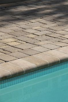 NewLine Hardscapes' English Cobble 4pc™ paver system gives you the ability to lay pavers in a totally random pattern. There are many design options to give you a variety of appearances. Its antiqued surface and edges lend a soft look and a feel of timeless sophistication, while blending seamlessly with our Coping unit to provide a smooth, soft roll to the edge of your swimming pool. Coping is available in both standard and tumbled finishes.