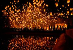yi peng (second full moon) lantern festival in chiang mai, thailand. wish lanterns, also known as khoom loy or khoom fay, are symbolic in thailand of problems and worries floating away.