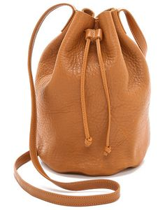 Drawstring bucket bag by Baggu. A minimalist Baggu handbag. The wrinkled leather is gathered at the top by a drawstring and the shoulder strap. Unlin...