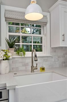 Kitchen Farmhouse Sink. Window with Roman Shade above farmhouse sink. #FarmhouseSink  #FarmhouseKitchenSink  Allison Knizek Design for Prescott Properties