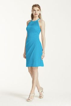 A stylish, short and chic bridesmaid dress that is a flattering look from the bridal party to a cocktail party!  Sleeveless bodice features round illusion mesh neckline.  Ultra-feminine body con fit with side cascade and back ruching finishes off the look.  Fully lined. Back zip. Imported polyester. Dry clean.  To protect your dress, try our Non Woven Garment Bag.Also available in Extra Length as Style 2XLF15612.