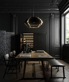 Combining Art Deco elements with modern furniture. Great use of black painted walls and mouldings
