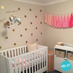 """Three inch gold polka dot wall decals in a very modern white nursery. (customer shared photo) Use promo code """"pin427"""" for 15% off!"""