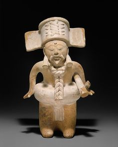 This mold-made ceramic figure depicts a bearded, mustachioed male wearing a ballgame yoke around his waist to protect him from the hard, solid rubber ball used in play. There are cylindrical ear ornaments in his ears and, beneath his arm, a batonlike object perhaps related to the local incarnation of the ballgame. The rules and manner in which the Mesoamerican ballgame was played varied among contemporary sites and evolved through time. Surviving evidence suggests human sacrifice was a…