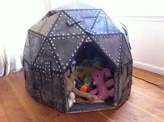DIY cardboard play dome for the kids - totally doable with just a few moving boxes!  Very cool idea and much cheaper than buying one.