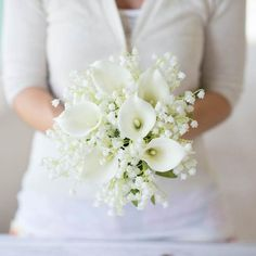 Step 1: Gather theitems you will need to create your bouquet.This bouquet features the Real Touch Calla Lily Bouquet and artificial Lily of the Valley. Step 2: Take apart the Calla Lily bouquet so you can use the individual stems. Step 3: Bundle together the Lily of the Valley in one hand and add the Real Touch Calla