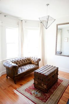 A chesterfield sofa and antique-trunk cocktail table, together at last. #refinery29 http://www.refinery29.com/white-rooms-decor-inspiration#slide-10