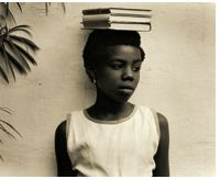 Vivian Maier (1926-2009) Known for the deep intimacy she had for her photography, Maier was a collector of moments from behind the lens of her camera. Young Black woman, placing books (and education) on her head, symbolically above herself. Education is for all, not just the privileged wealthy white people