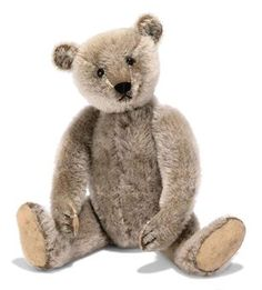 A STEIFF BROWN TEDDY BEAR, (5322), jointed, mohair faded to grey, black boot button eyes, black stitching, growler and FF button, circa 1910 --12½in. (32cm.) high (mohair faded to grey, some general wear and thinning, small holes to hand pads)